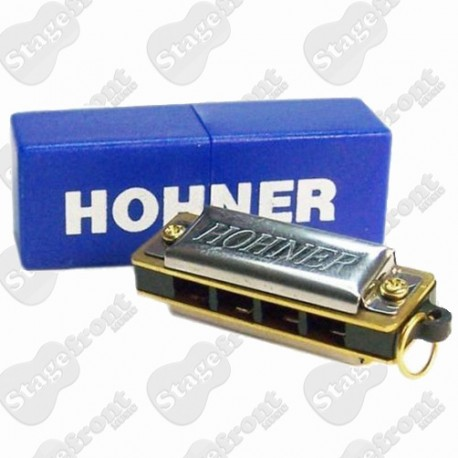 HOHNER PUCK 10 HOLE HARMONICA BRIGHT SOUNDING. LESS THAN 3 INCHES